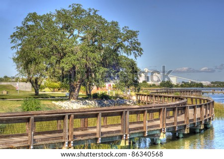 View of Industry from Riverfront Park in North Charleston, SC in HDR Style. - stock photo