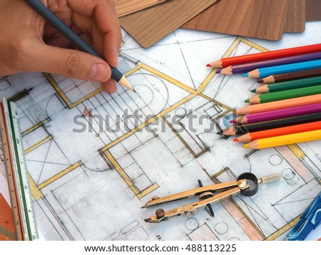 view of Interior designer hands working on table with home renovation concept