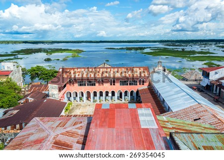 View of Iquitos, Peru with the Itaya River in the background in the Amazon Rainforest.  Iquitos is the largest city in the world with no road connection. - stock photo