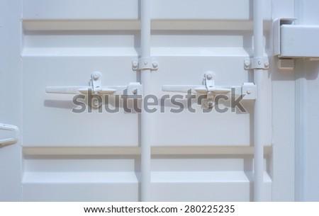 View of iron white door with iron handle - stock photo