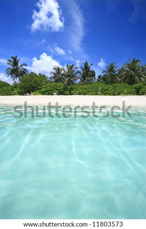 View of island and tropical sea, Maldives - stock photo