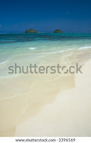 view of islands from shore in hawaii - stock photo