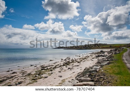 View of Islay coastline and cairn - stock photo