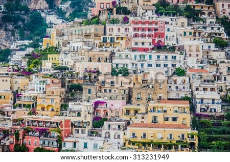 view of italian city positano situated on amalfi coast during summer sunset - stock photo