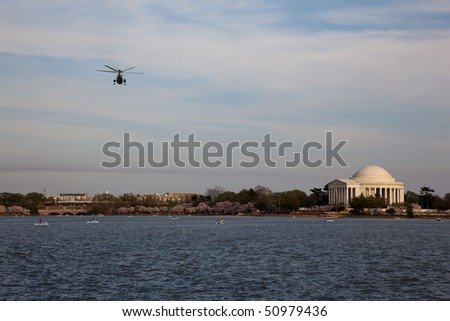 View of Jefferson Memorial with Helicopter flying across the sky - stock photo