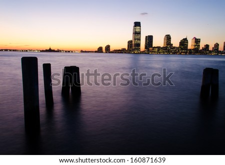 View of Jersey City from Battery park at sunset (Manhattan, New York) - stock photo