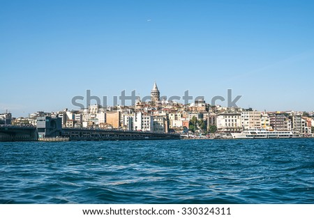 View of Karakoy, Galata bridge, Galata Tower and the Golden Horn from Eminonu coast in Istanbul, Turkey - stock photo
