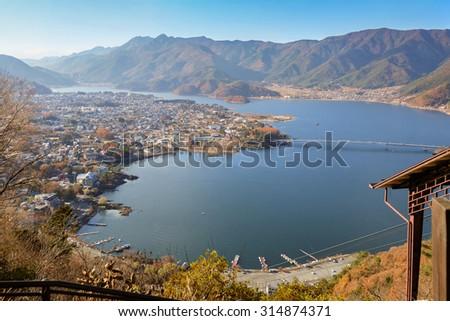View of Kawaguchi lake and village seen from Kawaguchiko Tenjoyama Park Mt. Kachi Kachi Ropeway - stock photo