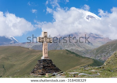 View of Kazbeg mountain and a cross, by the trinity church, Georgia