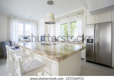 View of kitchen island in bright house - stock photo