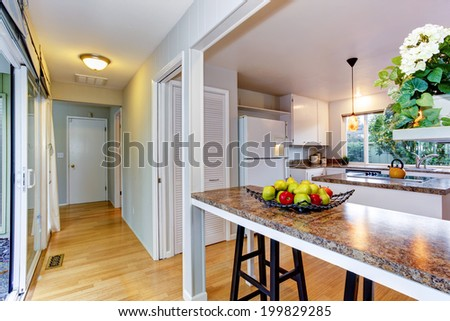 View of kitchen room with bar counter and empty corridor - stock photo