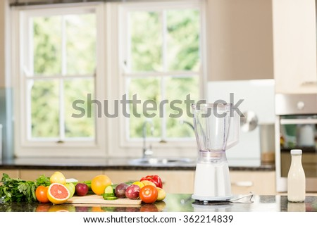 View of kitchen with mixer and fruit on counter - stock photo