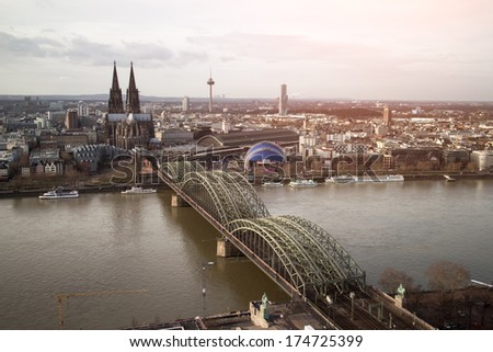 View of Koeln, Germany. Gothic cathedral and steel bridge over river Rhine