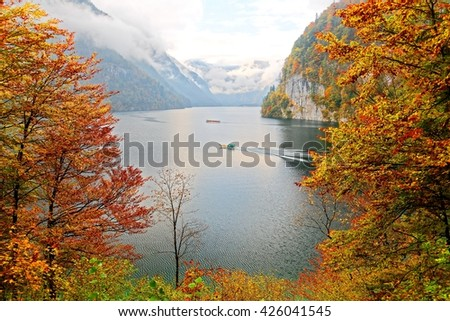 View of Koenigssee ( King's Lake) surrounded by alpine mountains from Malerwinkel viewpoint in colorful autumn season ~ Beautiful scenery of Bavarian countryside in Berchtesgaden Germany - stock photo