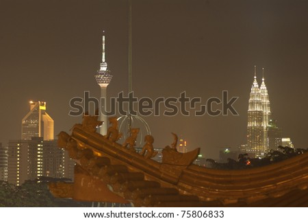 View of Kuala Lumpur city at night from chinese temple, Malaysia - stock photo