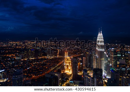 View of Kuala Lumpur skyscrapers during blue hour.