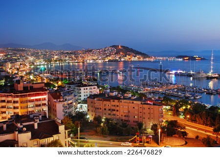 View of Kusadasi harbor by night. Turkish  - stock photo
