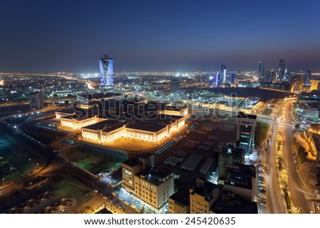 View of Kuwait City at night, Middle East - stock photo