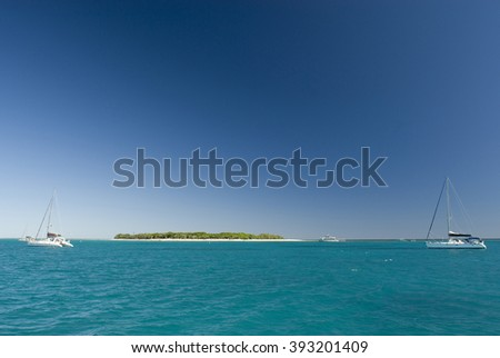 View of Lady Musgrave Island in Australia, the second of the islands on the Great Barrier Reef and a popular camping destination for tourists - stock photo