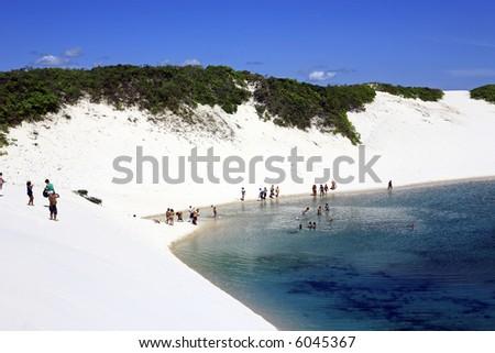 view of lagoa azul in desert sand dunes of the Lencois Maranheses National Park in brazil - stock photo