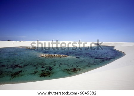 view of lagoa azul in desert sand dunes of the Lencois Maranheses National Park in brazil - stock photo