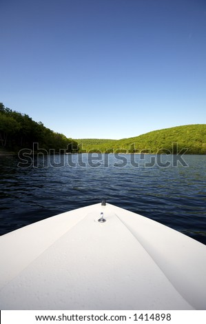 View of lake with Bow of boat in Foreground - stock photo