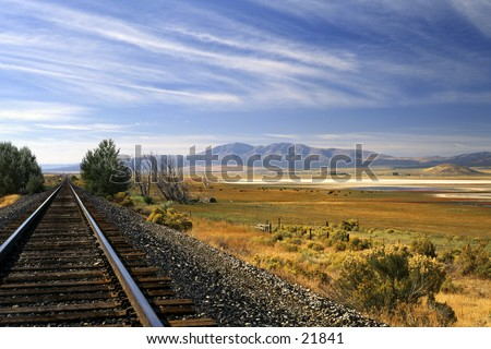 View of landscape from railroad tracks - stock photo