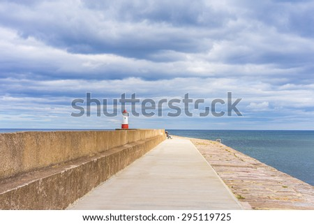 View of lighthouse and ocean coastline, South of Scotland - stock photo