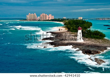 View of lighthouse in Nassau, Bahamas and tourist resorts in the city, - stock photo