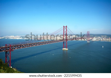 View of Lisbon and 25 de pbril bridge over Tagus river - stock photo