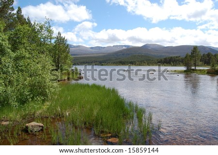 view of loch morlich in the highlands of scotland - stock photo