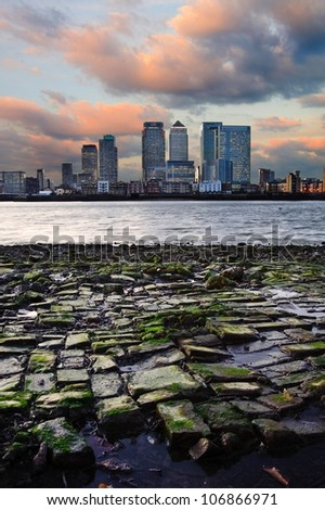 View of London City skyline at night on clear sky with reflections in River Thames - stock photo
