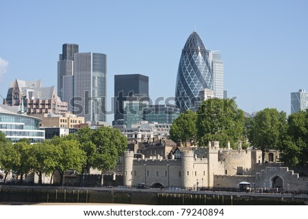 View of London's skyline showing the Gherkin and Tower of London - stock photo