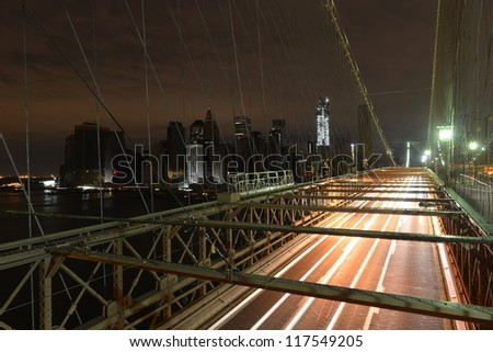 View of Lower Manhattan following power outage as a result of Hurricane Sandy from Brooklyn Bridge. - stock photo