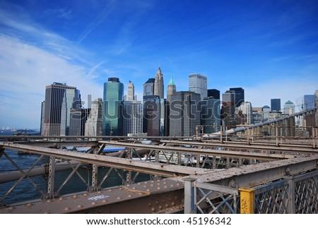 view of lower Manhattan from Brooklyn bridge - stock photo