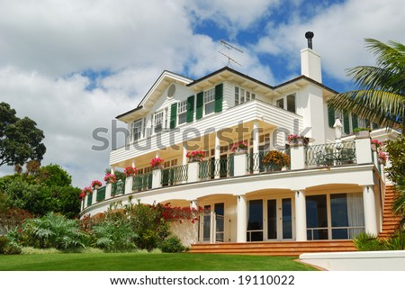 view of luxury home from backyard - stock photo