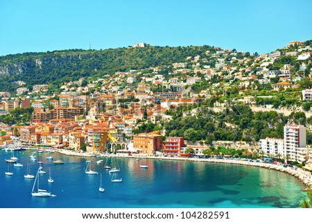 view of luxury resort and bay on sunny day. Villefranche-sur-Mer, Cote d'Azur, french reviera, near Nice and Monaco - stock photo