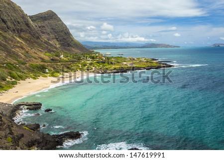 View of Makapuu Beach and the Koolau Mountains looking towards Waimanalo Bay on Oahu, Hawaii - stock photo