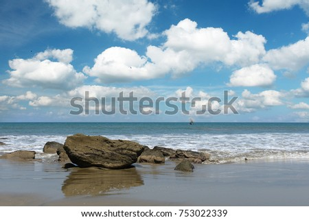 View of Mancora Beach in Peru with clouds and blue sky