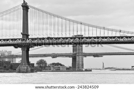 View of Manhattan Bridge, Brooklyn Bridge, and Statue of Liberty. - stock photo