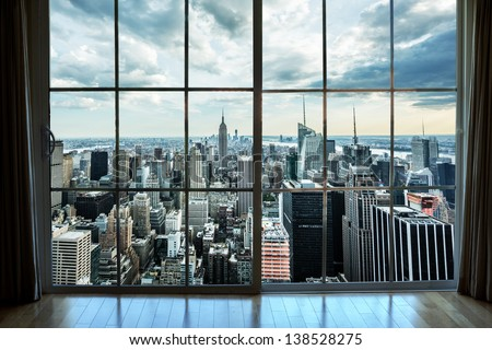 View of Manhattan New York City Skyline Buildings from High Rise Window - Beautiful Expensive Real Estate overlooking Empire State Building and Skyscrapers in Gorgeous Breathtaking Penthouse Cityscape - stock photo