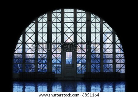 View of Manhattan through windows at Ellis Island. - stock photo