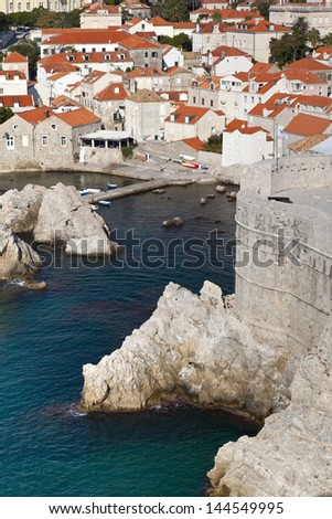 View of many landmarks of Old town in city of Dubrovnik, Croatia. Classic orange tiled rooftops are very famous in Dubrovnik. - stock photo