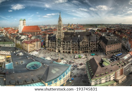 View of Marienplatz (Mary's Square) in Munich, Bavaria, Germany, on a warm, cloudy spring day. - stock photo