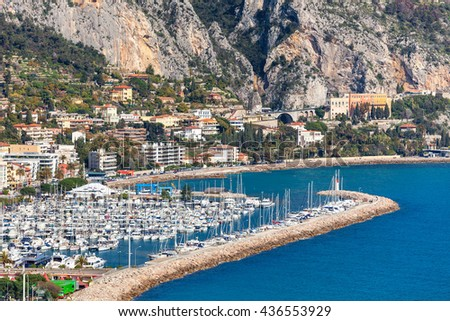 View of marina with yachts along shoreline of Menton - small town on French Riviera.