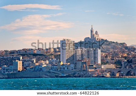 View of Marseille with cathedral Notre Dame de la Garde in France from the sea - stock photo