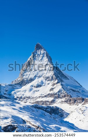 View of Matterhorn on a clear sunny day on the winter hiking path, Zermatt, Switzerland - stock photo