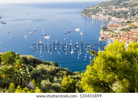 View of Mediterranean luxury resort and bay with yachts. Nice, Cote d'Azur, France. French Riviera - turquoise sea and perfect blue sky. - stock photo