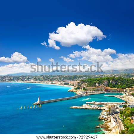 View of mediterranean resort, Nice, Cote d'Azur, France. turquoise sea and perfect sunny blue sky. - stock photo