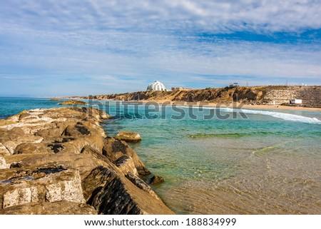 View of Mediterranean sea shoreline from breakwater in Ashkelon, Israel. - stock photo